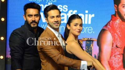 Varun Dhawan, Alia Bhatt and their director Shashank Khaitan were spotted at an event for Singapore Tourism on Monday to promote their film 'Badrinath Ki Dulhania.' (Photo: Viral Bhayani)