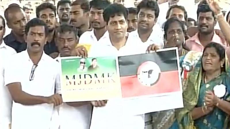 Madhavan with party workers after launching MJDMK at Marina beach in Chennai on Friday. (Photo: ANI Twitter)