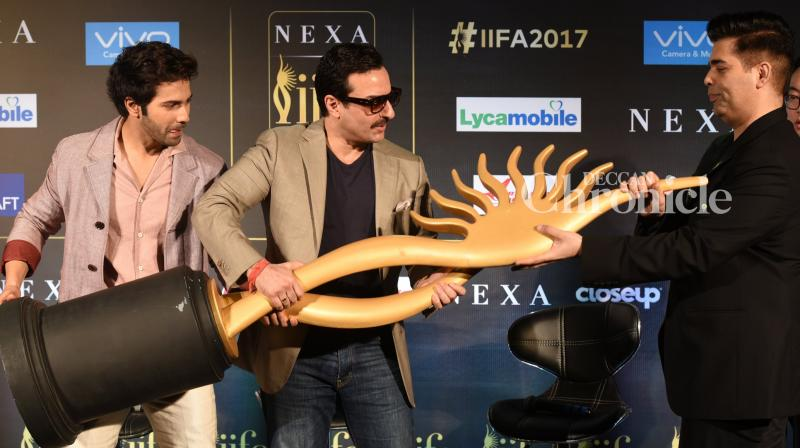 Varun Dhawan, Saif Ali Khan and Karan Johar were spotted at a press conference for the IIFA Awards in Mumbai on Monday. (Photo: Viral Bhayani)