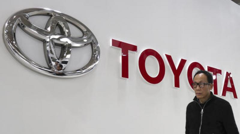 Toyota See Profit Drop on Yen, President Promises Change