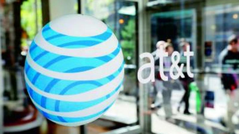 Dallas-based AT&T said late Saturday the deal would need approval of the US Justice Department and the companies were determining which Time Warner US Federal Communications Commission licenses, if any, would transfer to AT&T as part of the deal.