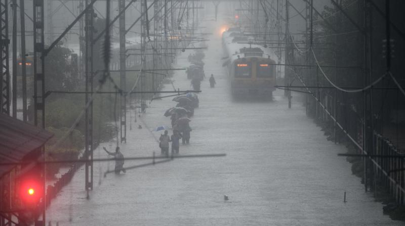 Heavy rainfall drowned Mumbai and its nearby areas on Tuesday and it looked like there was little respite in sight with the Met department predicting more showers over the next 24 hours. (Photo: Shripad Naik)