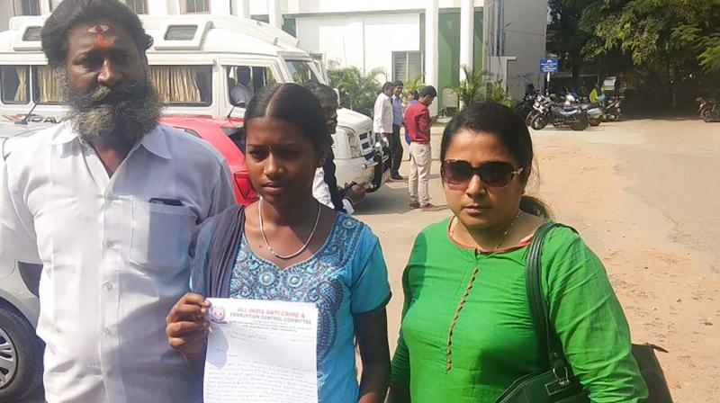 Class 9 girl petitions Coimbatore collector along with her parents  on Tuesday. (Photo: DC)