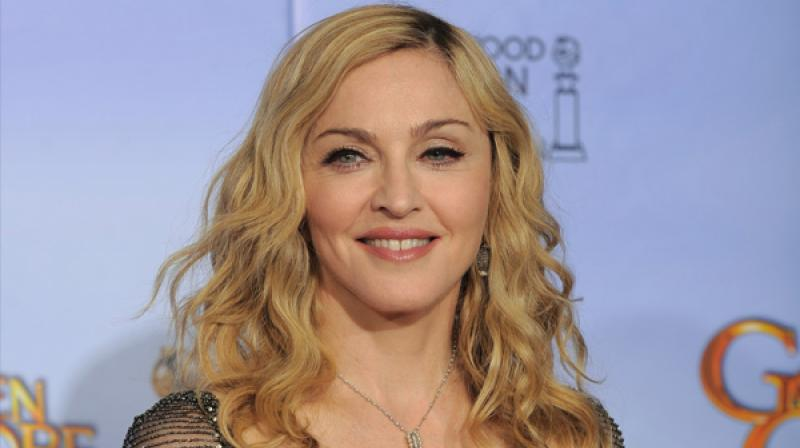 Madonna gets permission to adopt twin girls from Malawi