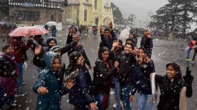 People celebrate the season's first snowfall in Shimla (Photo: AP)