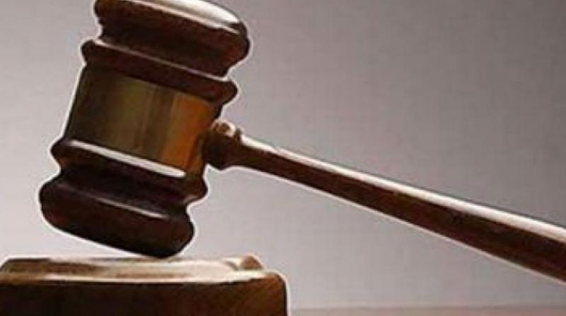 942 cases resolved in Lok Adalat held