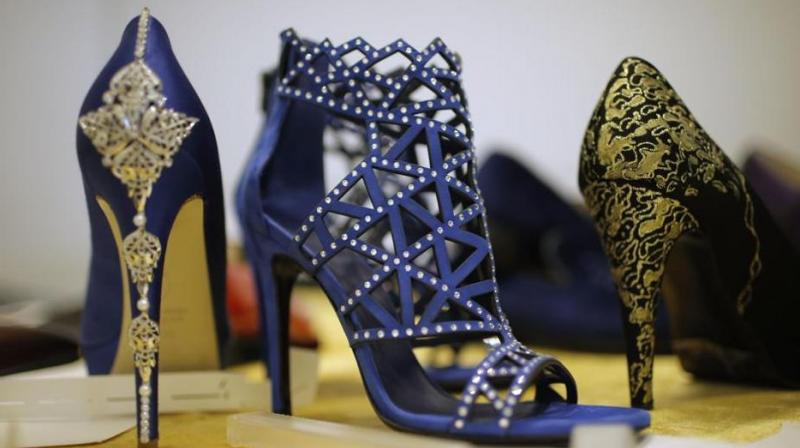Italian shoemaker Antonio Vietri hopes to attract shoppers from wealthy Gulf countries with his blue or black suede moccasins with stitched gold-plated uppers.