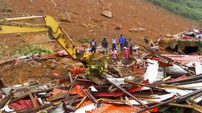 Mudslides and torrential flooding has killed many people in and around Sierra Leone's capital early Monday following heavy rains, with many victims thought to be trapped in homes buried under tons of mud.