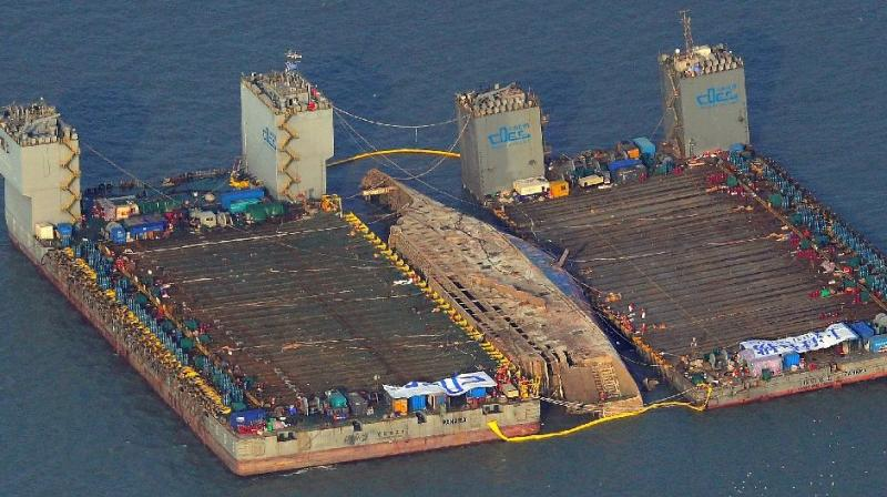 The damaged Sewol ferry was held afloat between two barges during a salvage operation off the South Korean island of Jindo (Photo: AFP)