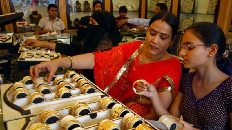 Women check out gold bangles at a jewellery shop. (Photo: PTI)