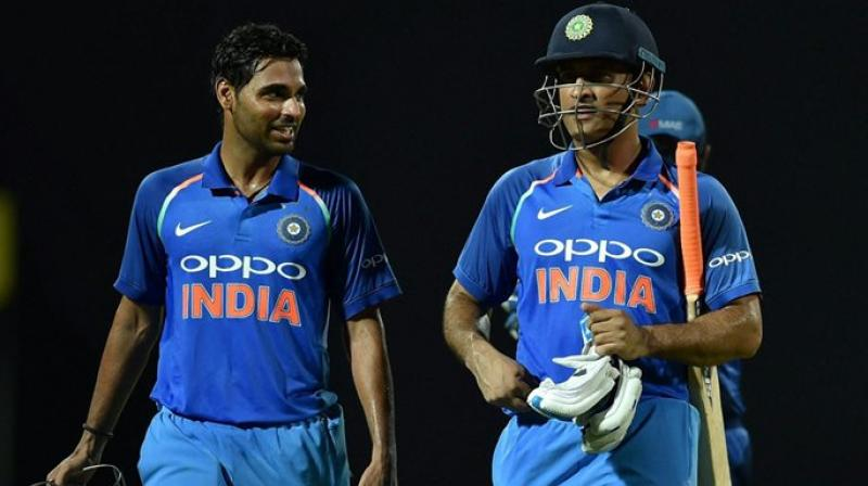 """""""If you look at his (MS Dhoni's) record, nobody (the team management) is really bothered. Whatever he has done, he has been doing well, he knows he is a legend. Whatever he is doing, it is benefitting the Indian team,"""" said Bhuvneshwar Kumar. (Photo: PTI)"""