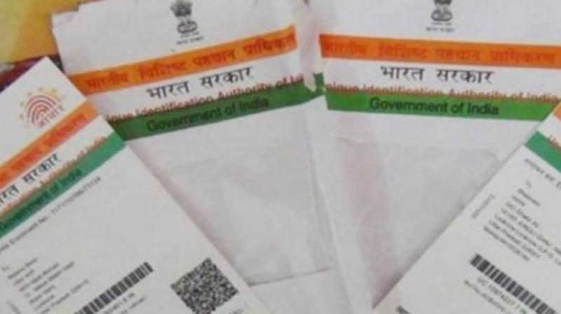 Aadhar now must for filing tax returns, new PAN from next month