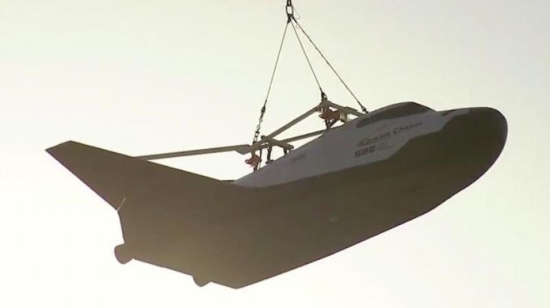 The Dream Chaser was lifted to an altitude at which it would be released for a free flight that is scheduled to happen later this year.