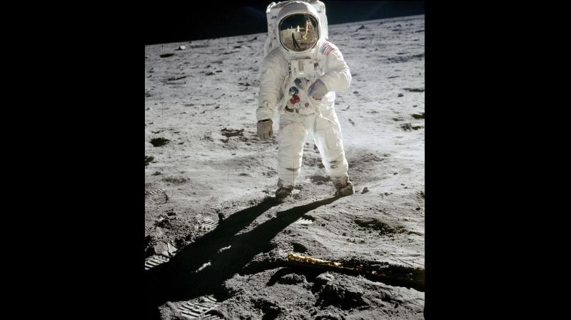 In this 1969 photo released by NASA, astronaut Buzz Aldrin walks on the surface of the moon near the leg of the lunar module Eagle during the Apollo 11 mission. Astronaut Neil Armstrong, who took the photograph, is reflected in Aldrin's visor. (Photo: AP)