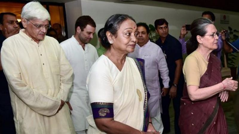 Congress President Sonia Gandhi with presidential candidate Meira Kumar and vice-presidential candidate Gopal Krishna Gandhi after the UPA meeting in New Delhi on Sunday. (Photo: PTI)