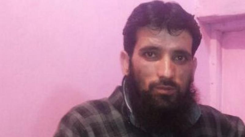 The Jammu & Kashmir Police on Friday detained Hizbul Mujahideen terrorist Gulzar Dar in Pulwama district's Tral. (Photo: ANI)
