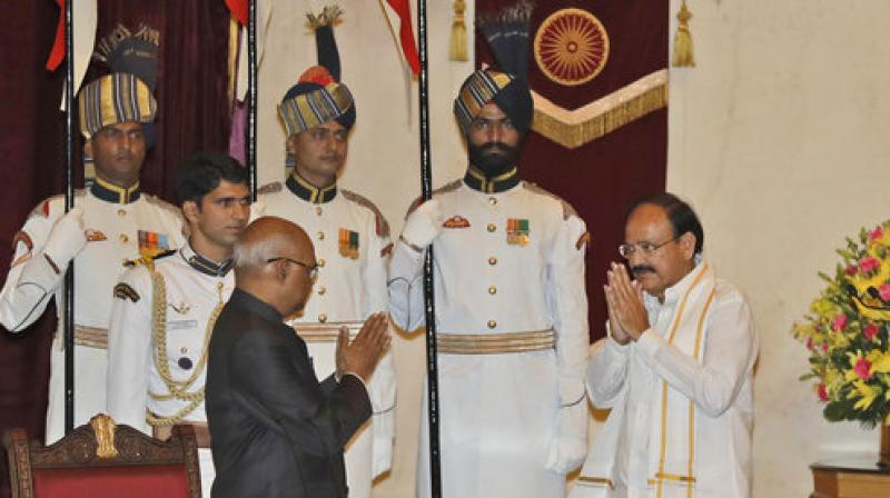 President Ram Nath Kovind administering the oath of office and secrecy to Venkaiah Naidu as India's Vice President in the Durbar Hall of Rashtrapati Bhawan in New Delhi on Friday. (Photo: PTI)