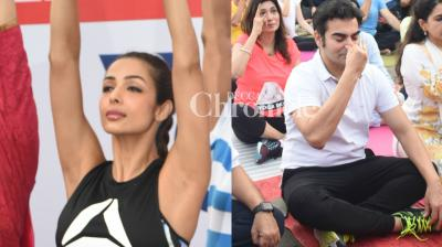 Former couple Malaika Arora Khan and Arbaaz Khan were spotted at the same event to spread awareness of Yoga on the occasion of International Yoga Day celebrated in Mumbai on Wednesday. (Photo: Viral Bhayani)