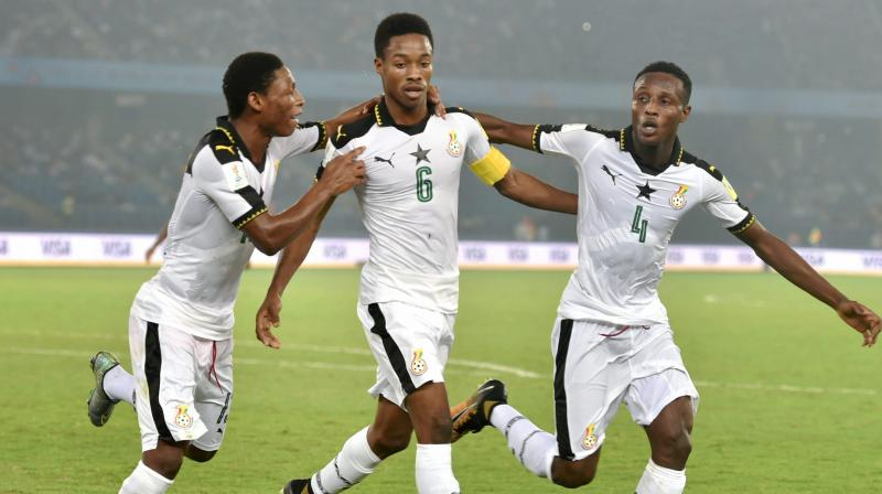 Ghana's Eric Ayiah (Jersey no 6) celebrates with teammates after scoring a goal against India on Thursday. (Photo: PTI)
