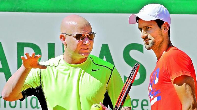 Agassi will not leave Wimbledon early, says Djokovic
