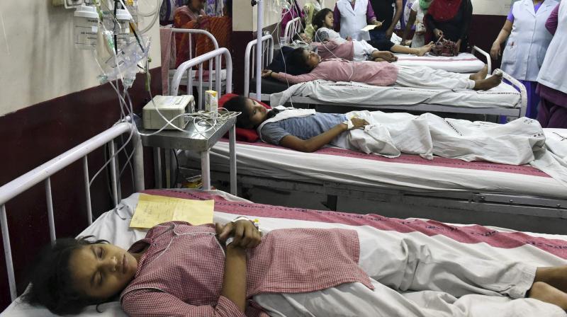 Students of the Rani Jhansi Sarvodaya Kanya Vidyalaya school receive treatment at a government hospital in New Delhi. (Photo: PTI)
