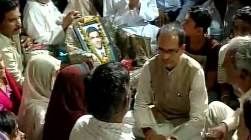 Madhya Pradesh Chief Minister Shivraj Singh Chouhan meets families of killed farmers in Mandsaur. (Photo: ANI | Twitter)