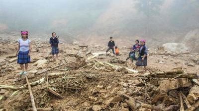 Floods and landslides caused by torrential rains have killed 26 people and left 15 missing in Vietnam's mountainous north, authorities said on Monday.