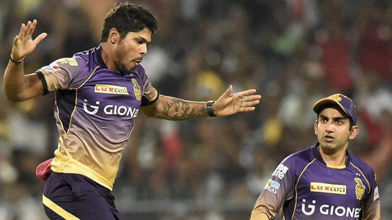 KKR captain Gautam Gambhir with teammate Umesh Yadav celebrate a wicket during IPL against RPS at Eden Garden in Kolkata on Wednesday. (Photo: PTI)