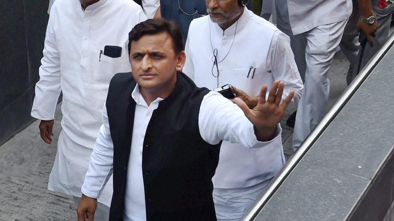 Evasive Mulayam says all is well in party, family; Akhilesh emerges stronger
