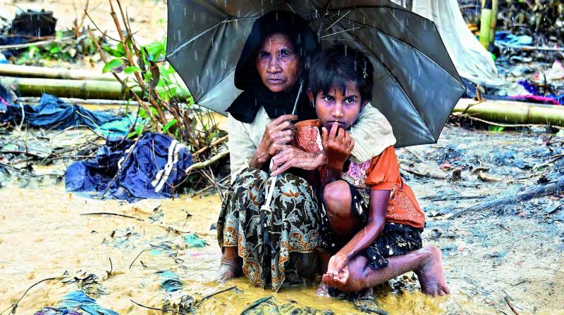 Refugees from Myanmar seek international aid, safety