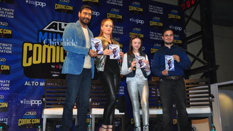 Ajay Devgn along with the actors of his directorial venture 'Shivaay' launched a comic of the film at the Comic Con event in Mumbai. (Photo: Viral Bhayani)