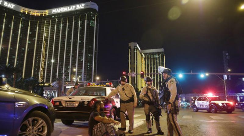 Las Vegas gunman fired at security guard before mass shooting
