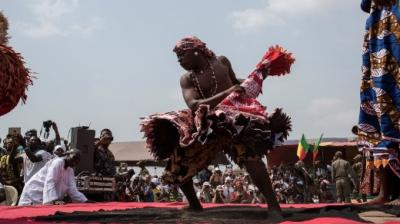 Every January, thousands of voodoo worshippers joined by crowds of tourists and descendants of slaves trudge down the long sand track leading to the beach at Ouidah in Benin.