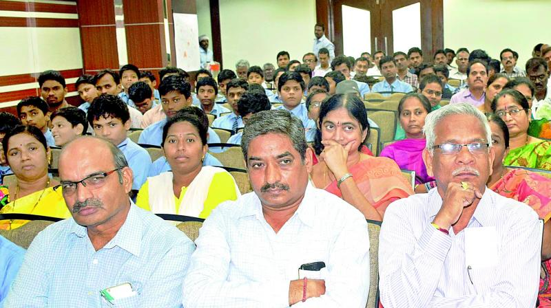 Architects, APREDA, CREDAI and other CRDA officials attending 'World Planning Day' in Guntur city. (Photo: DC)