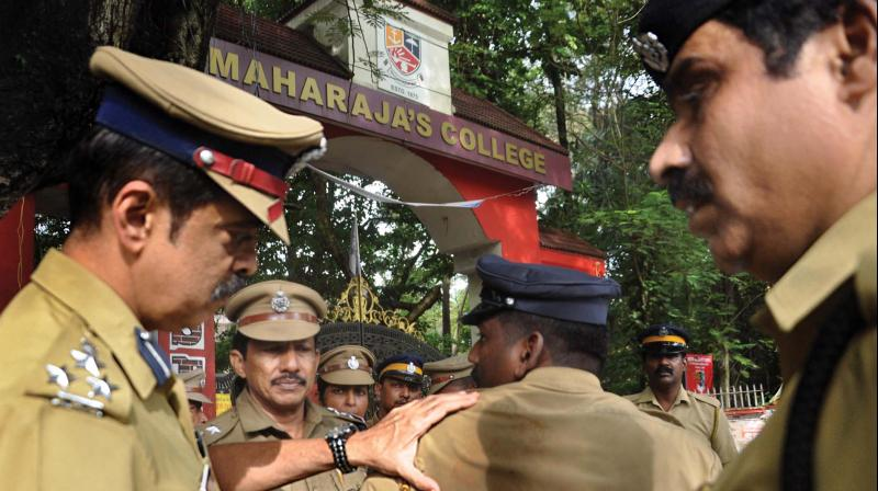 City police commissioner M.P. Dinesh examines a policeman who came under attack during a clash between two groups of students at Maharaja's College in Kochi on Friday.  (Photo: SUNOJ NINAN MATHEW)