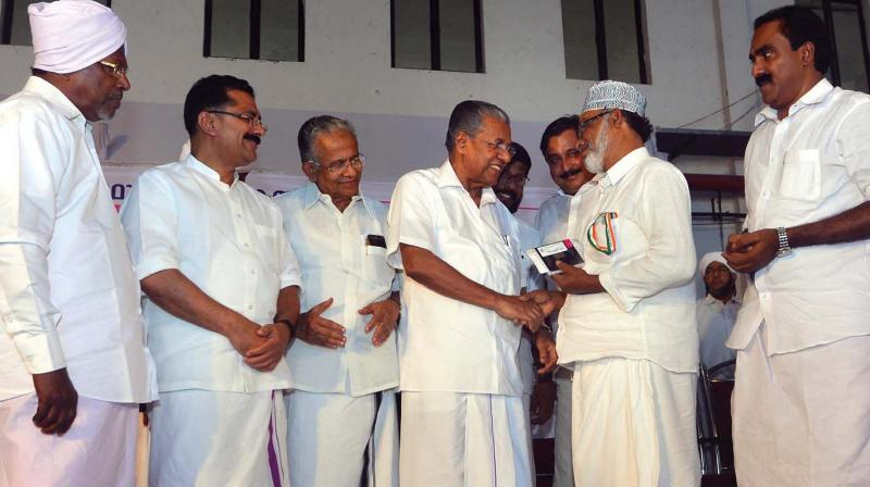 Chief Minister Pinarayi Vijayan inaugurates the distribution of travel documents for Haj pilgrims from the state at Nedumbassery airport on Saturday.