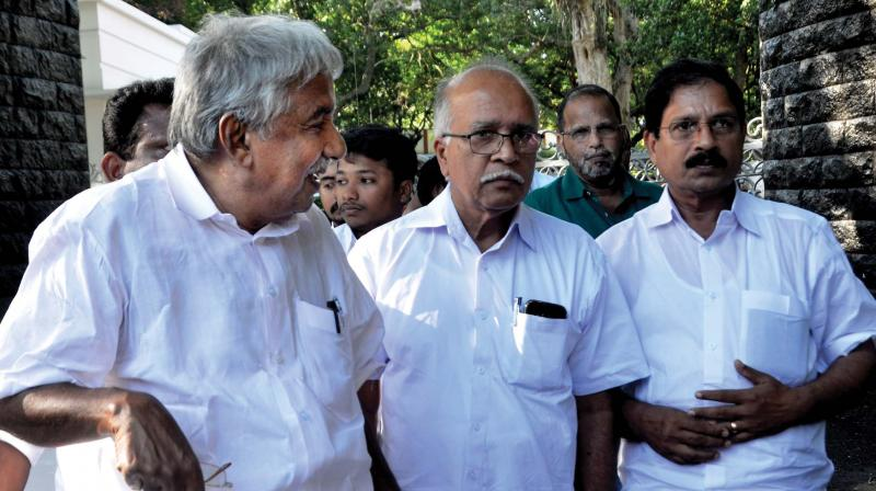 Former Chief Minister Oommen Chandy with the relatives of Fr. Uzhunnalil comes out of Raj Bhavan after meeting Governor seeking Uzhunnalil's release. (File pic)