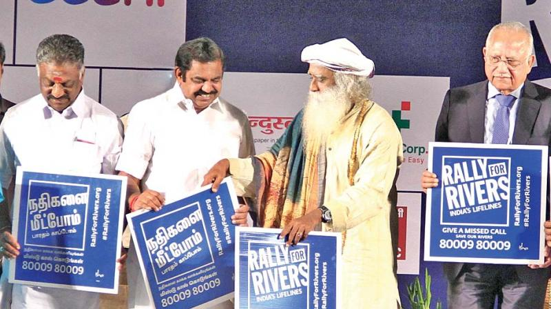 Chief Minister Edappadi K. Palaniswami is joined by Deputy CM O. Panneerselvam in pledging support to Isha Foundation's Rally for Rivers project. Spiritual leader Sadhguru Jaggi Vasudev and Apollo Hospitals Chairman Dr Prathap C. Reddy are also seen (Photo: DC)