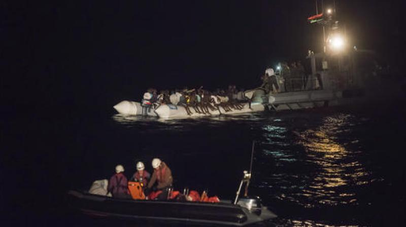 Image result for African migrants perished after rickety boat fell apart in the Mediterranean Sea - Libyan Navy