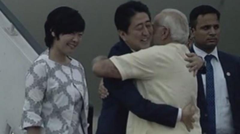 Modi receives Japanese Prime Minister Shinzo Abe and his wife Akie Abe at Ahmedabad Airport. (Photo: ANI | Twitter)