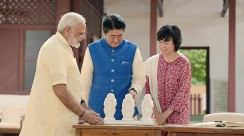 Prime Minister Narendra Modi explains to Japanese Prime Minister Shinzo Abe and his wife Akie about the concept of the 'three wise monkeys' of Mahatma Gandhi, at Gandhi Ashram in Ahmedabad on Wednesday. (Photo: PTI)