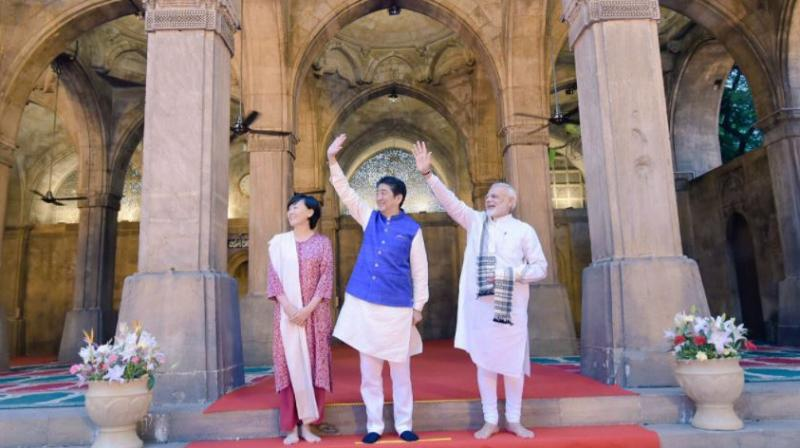Modi, Japanese PM Shinzo Abe and his wife Akie Abe at 'Sidi Saiyyid Ni Jaali', the famous 16th century mosque in Ahmedabad. (Photo : MEA_India | Twitter)