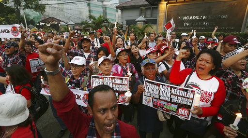 Thousands of protesters gathered in front of a Jakarta prison in support of the former Christian governor imprisoned for two years for blasphemy against Islam.