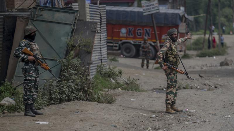 Indian army soldiers stand guard at the site of shootout in Batengoo about 50 Kilometres (31.25 miles) south Srinagar, Indian controlled Kashmir. (Photo: AP)