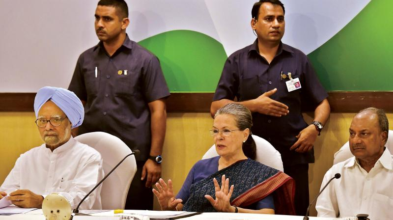 Congress president Sonia Gandhi with former prime minister Manmohan Singh at the Congress Working Committee meeting in New Delhi on Tuesday. (Photo: PTI)