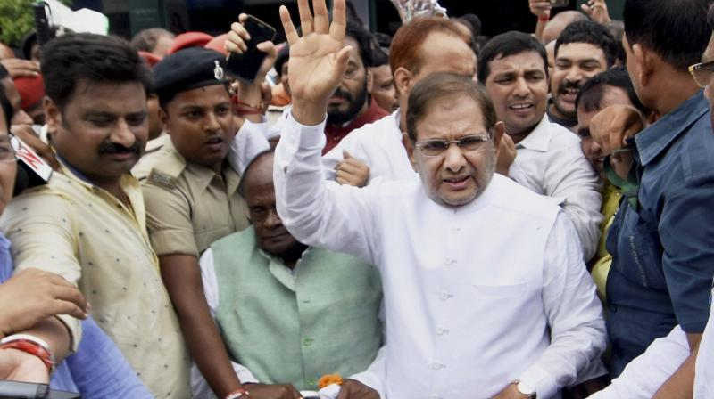 Senior JD(U) leader Sharad Yadav speaks to the media after arriving at the Jay Prakash Narayan International Airport in Patna on Thursday. (Photo: PTI)