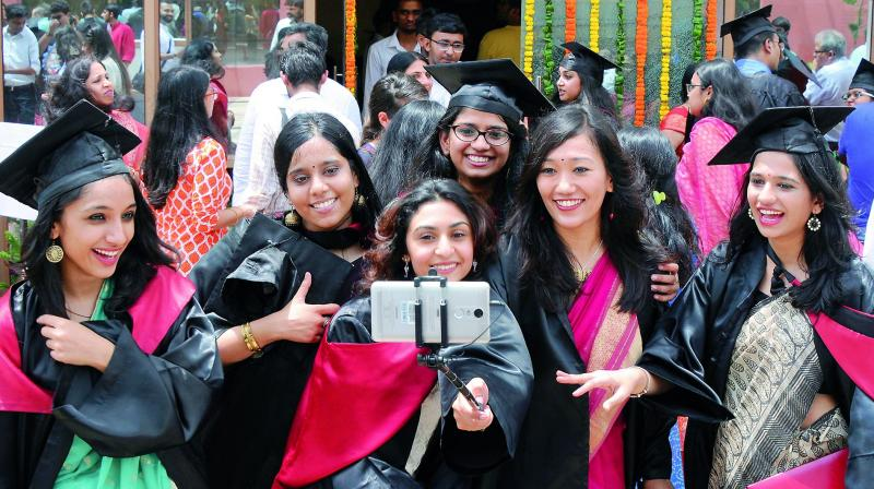 National Law University Delhi students take selfie during their annual convocation ceremony in New Delhi on Saturday.