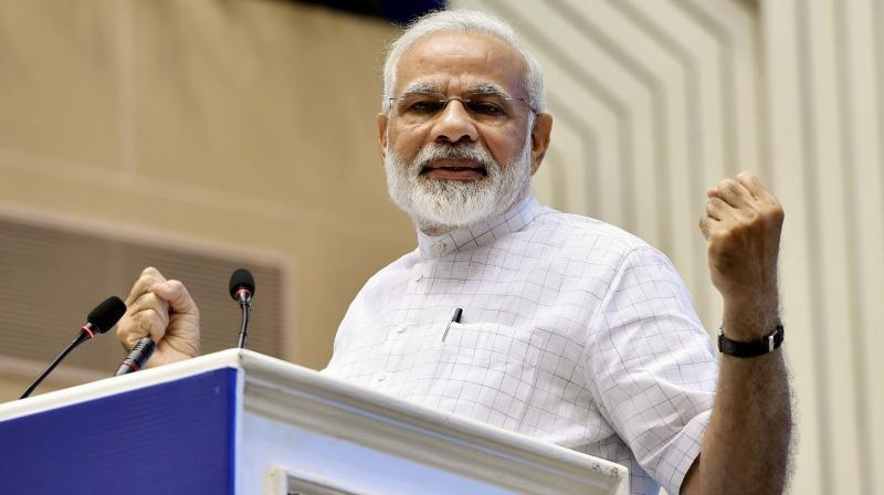 Prime Minister Narendra Modi addresses during a function on the occasion of 125th anniversary of Vivekananda's Chicago Address and birth centenary of Deendayal Upadhyay in New Delhi on Monday. (Photo: PTI)