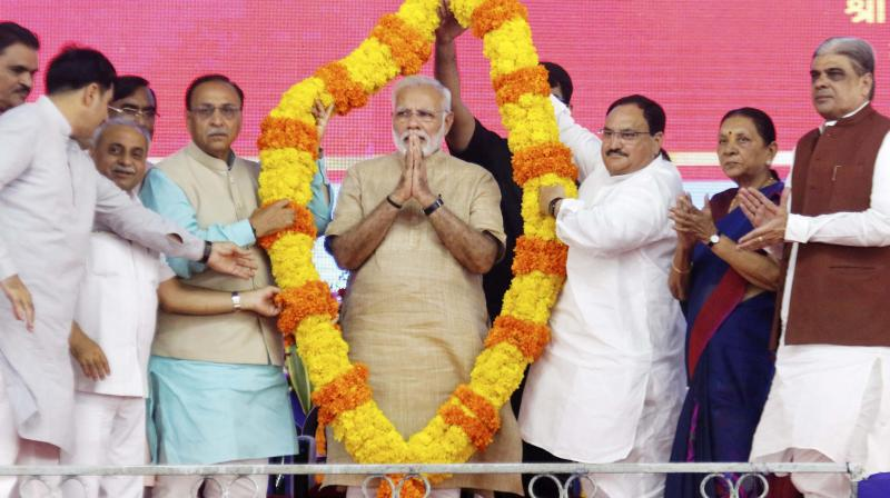 Prime Minister Narendra Modi being felicitated at a public meeting in his hometown Vadnagar