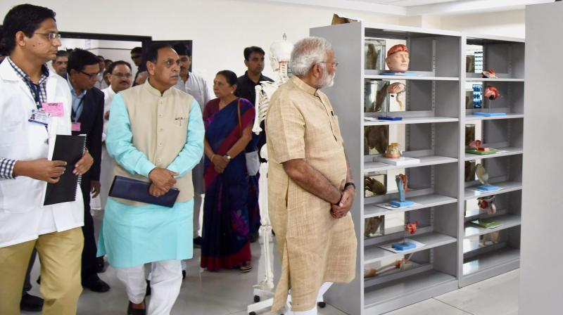 Prime Minister Narendra Modi during a visit to GMERS Medical College Vadnagar Gujarat on Sunday. Chief Minister of Gujarat Vijay Rupani is also seen